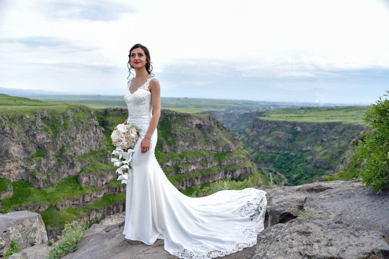 Mane in Miss Stella York wedding dress